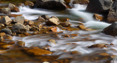 Water cascades down Tenaya Creek at the junction between Upper and Lower Mirror Lakes.