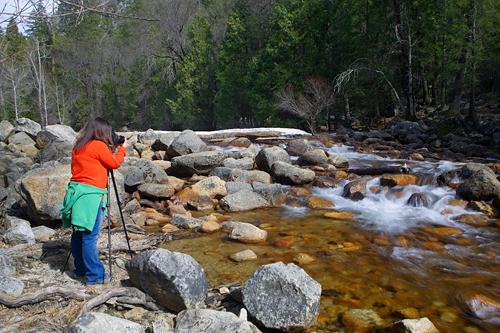 Leana D. shooting the flowing water on Tenaya Creek.